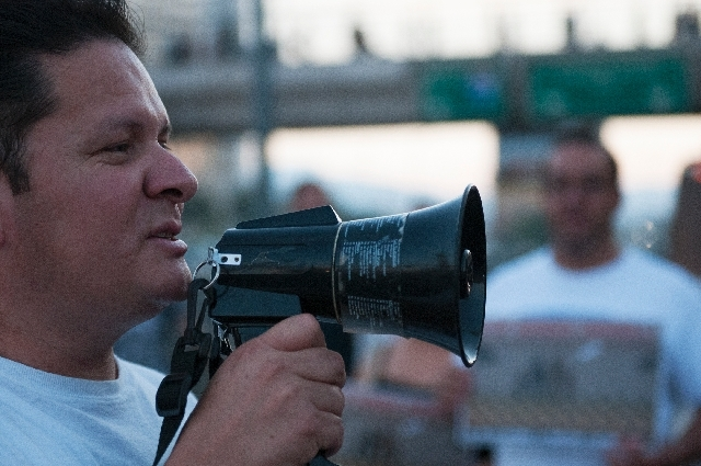 Carlos Silva, yells a chant during a demonstration protesting a border militarization at an immigration rally on Wednesday in front of the New York-New York in Las Vegas.