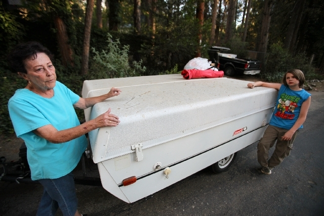 Dustin Leadbetter,11, right, prepares to evacuate his home on South circle Drive in Idyllwild,Calif., Wednesday.