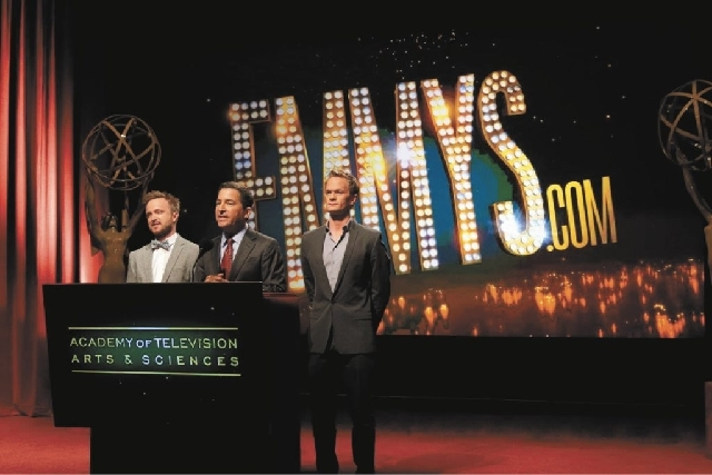 Actor Aaron Paul, left, Academy of Television Arts & Sciences Chairman and CEO Bruce Rosenblum and actor Neil Patrick Harris announce nominations Thursday morning at the 65th Primetime Emmy Nomina ...