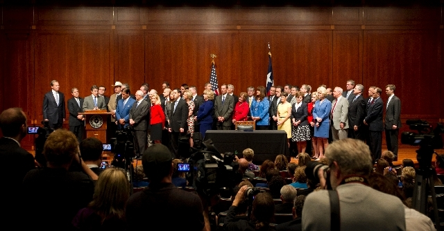 Gov. Rick Perry, third from left, speaks at a signing ceremony for the the abortion restriction bill, House Bill 2, at the Capitol in Austin, Texas, on Thursday.