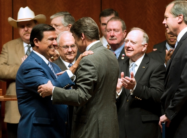 Sen. Eddie Lucio Jr., left, greets Gov. Rick Perry at a signing ceremony for the abortion restriction bill, House Bill 2, at the Capitol on Thursday.