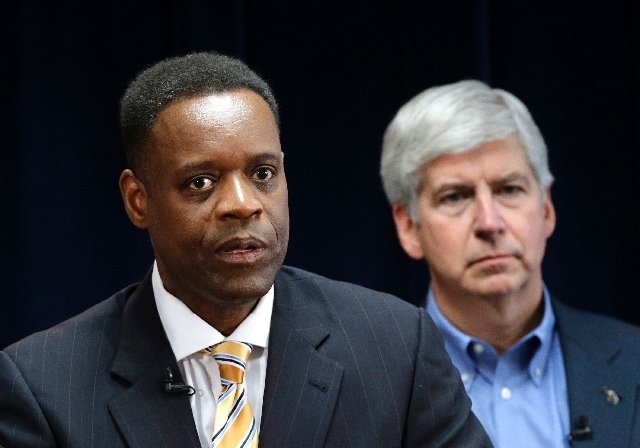 In this March 14 photo Detroit emergency manager Kevyn Orr, left, speaks at a news conference in Detroit as Michigan Gov. Rick Snyder, who appointed Orr, listens.