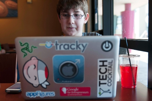 Ethan Duggan, 12, uses his laptop on Wednesday at Panera Bread in Henderson. Duggan is an app developer who will present his apps at SXSW conference at the Cosmopolitan in August.