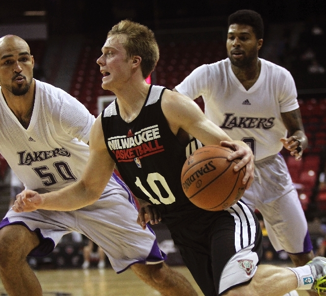 Milwaukee's Nate Wolters (10) drives past the Lakers' Robert Sacre (50) and Chris Douglas-Roberts during the NBA Summer League at the Thomas & Mack Center on Thursday.