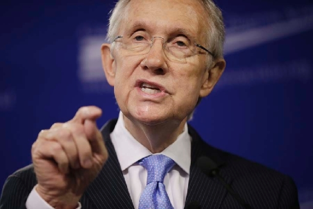 Senate Majority Leader Harry Reid, D-Nev., repeated his assertion Thursday that climate change is a reality and a cause for wildfires in the West. He is shown here speaking at the center for Ameri ...