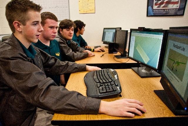 Rancho High School aviation program Class of 2012 seniors, from left, team leader Josh Emig, 17, Cameron Wall, 17, Victor Santisteban, 17, and Matthew Flores, 18, work on the aircraft design proje ...