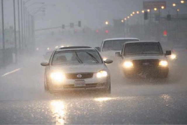 Motorists drive through standing water from heavy rains at the intersection of Silverado Ranch Boulevard and Gilespie Street in Las Vegas in August 2012. Thunderstorms could wreak havoc on Mount C ...