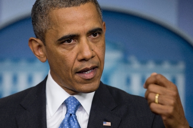 President Barack Obama speaks to reporters in the Brady Press Briefing room of the White House in Washington Friday.