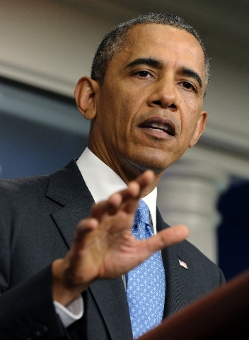 President Barack Obama pauses as he speaks to reporters in the Brady Press Briefing room of the White House in Washington Friday. Obama says black Americans feel pain after the Trayvon Martin verd ...