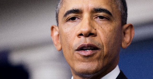 President Barack Obama pauses as he speaks to reporters in the Brady Press Briefing room of the White House in Washington Friday.