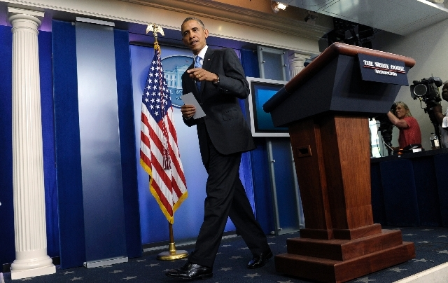 President Barack Obama walks from the podium after speaking about the death of Trevyon Martin at the beginning of the daily White House briefing in the Briefing Room of the White House in Washingt ...