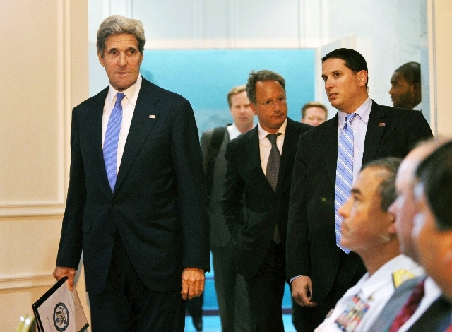 U.S. Secretary of State John Kerry, left, arrives for a press conference at Queen Alia International Airport on Friday,  July 19