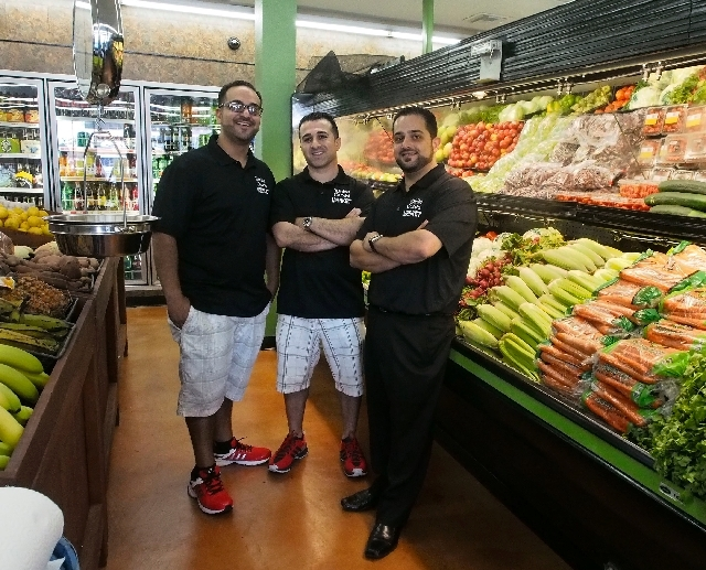 Owners, left to right, Jimmy Shoshani, Rimon Hirmiz and Nick Shoshani stand in the produce area at the new White Cross Market on Las Vegas Boulevard on Friday. The market will open to the public S ...