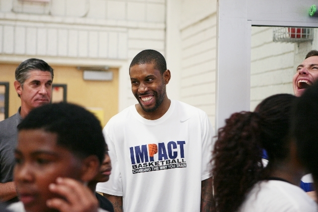 Indiana Pacers guard C.J. Watson, a Bishop Gorman High product, greets participants at the Hoops for Hope basketball camp at Doolittle Community Center on Friday.