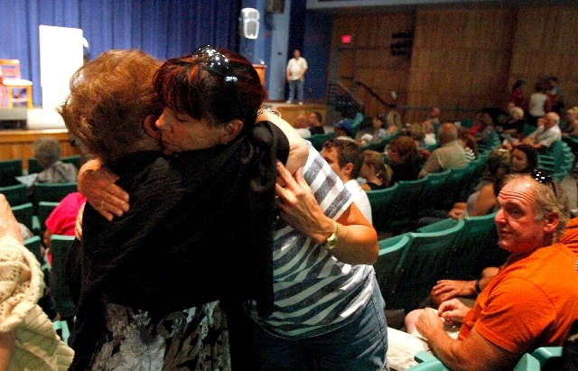 Rose Meranto, left, and stepdaughter Pam, residents of Mount Charleston's Old Town area, embrace before a July 7 meeting about the Carpenter 1 Fire at Centennial High.