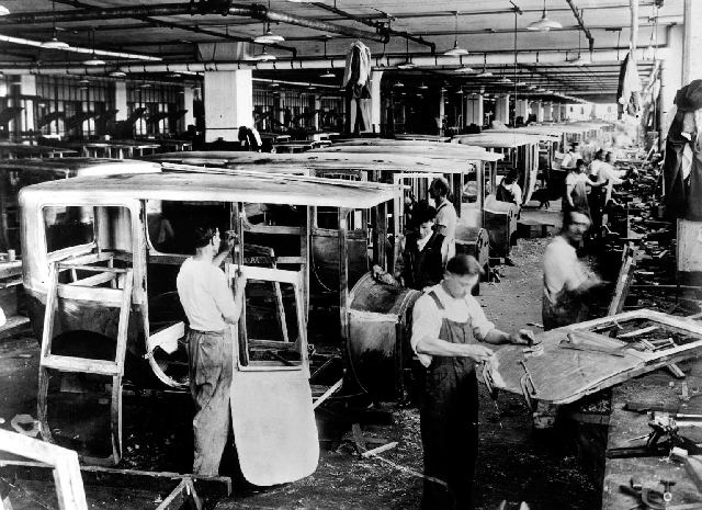 This 1920s photo shows employees working in the Packard Motor Car Co. in Detroit.
