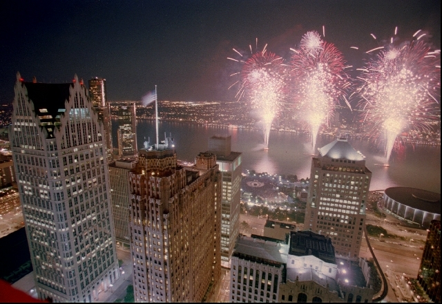 In this June 26, 1996 file photo, the 38th Freedom Festival fireworks display lights up the skies over the Detroit River as seen from downtown Detroit with Windsor, Ontario, in the background.