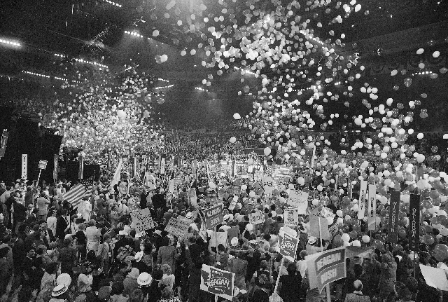In this July 17, 1980 file photo, a shower of balloons drops from the top of the Joe Louis Arena in Detroit where the Republican National Convention heard Ronald Reagan accept the nomination for p ...