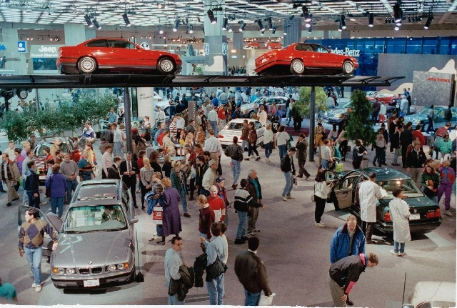 In this Jan. 9, 1993 file photo, thousands of people visit Cobo Center in Detroit for the North American International Auto Show.
