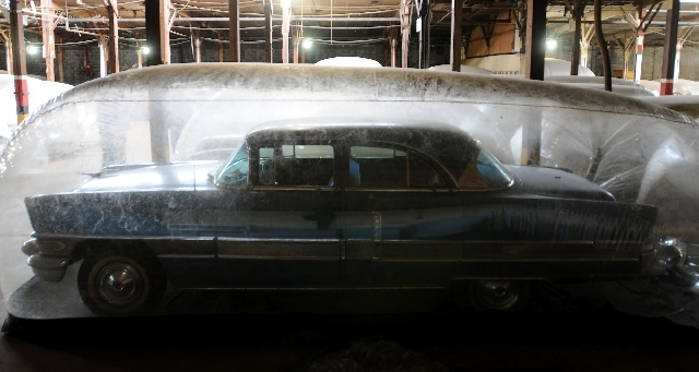 A 1956 Packard Partrician is housed in a protective bubble in the Detroit Historical Society's storage area at the Historic Fort Wayne in Detroit, Feb. 8, 2011.