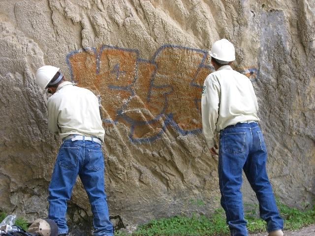 Two teenagers from the Spring Mountain Youth Camp chisel graffiti off the face of a cliff at Big Falls on Mount Charleston in this 2007 file photo. The Carpenter 1 Fire forced the relocation of ad ...