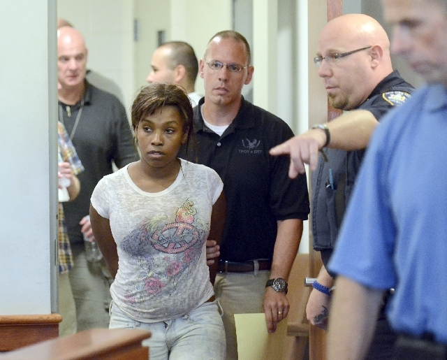 Audrea Gause, 26, of Troy, N.Y., is led into court in Troy, N.Y. on Friday to be arraigned on a Massachusetts fugitive warrant for defrauding the One Fund Boston of $480,000.