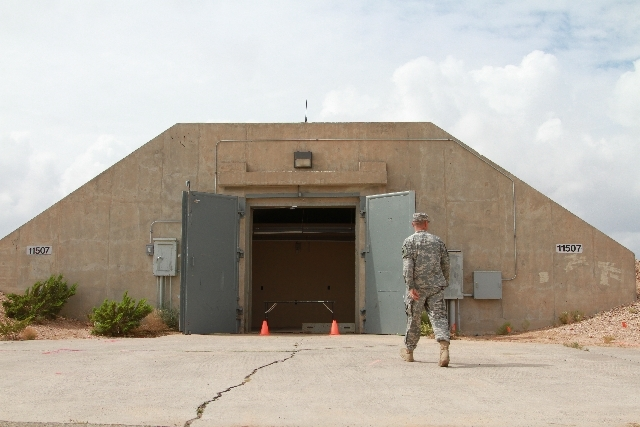 Lt. Col. Jason Crowe walks toward a radiation contaminated bunker at Ft. Bliss, Texas, Friday. F