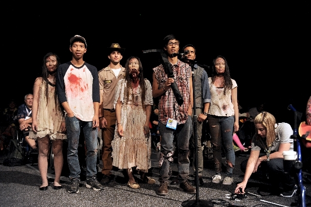 """Audience members participate in """"The Walking Dead"""" panel on Day 3 of Comic-Con International on Friday in San Diego."""