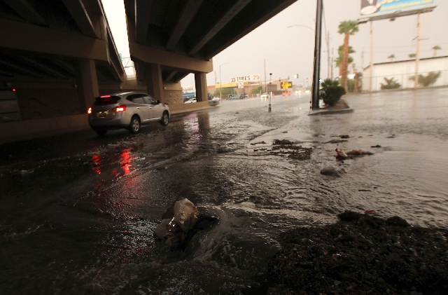 A flash flood spills onto Bonanza Road as thunderstorms roll over the Las Vegas Valley on Friday.