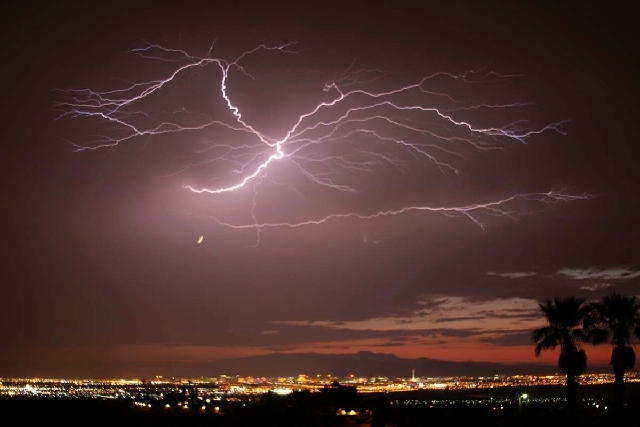 Lightning cracks over Las Vegas in this image taken at about 8:30 p.m. Friday from Henderson.