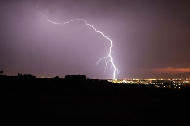 Lighting strikes during a powerful thunderstorm that rolled through Las Vegas on Friday night. This photo was taken from Henderson looking toward the Las Vegas Strip.