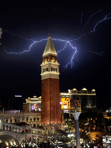 Lightning strikes over the Las Vegas Strip during storms on Friday night. High winds, rain and flash flash flooding struck the valley as the storm rolled through from the northeast.
