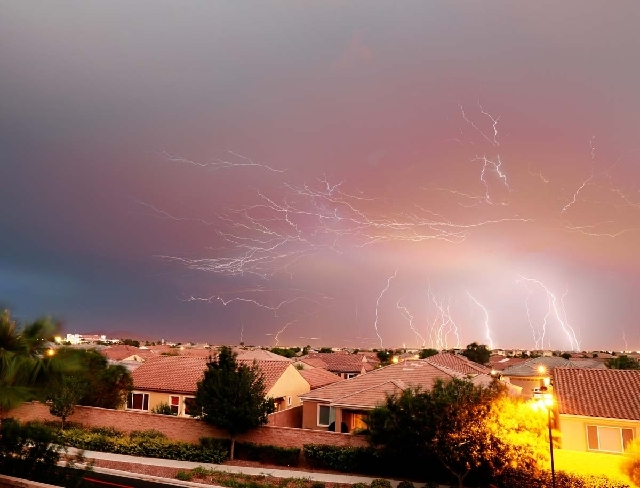 Lightning strikes fracture the clouds in this long exposure photographed by Robert Pernett in Northwest Las Vegas. The storm rolled in from the northeast and marched across the valley, dumping rai ...