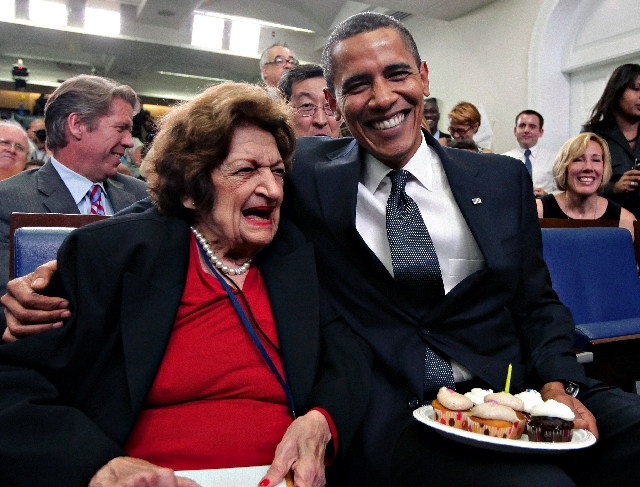 In this Aug. 4, 2009, file photo, veteran White House reporter Helen Thomas, left, celebrates her 89th birthday with President Barack Obama, celebrating his 48th birthday, in the White House Press ...