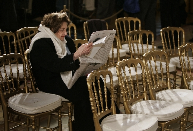 In this Oct, 25, 2006 file photo, Veteran White House reporter Helen Thomas arrives early and waits for a presidential event in the East Room of the White House.