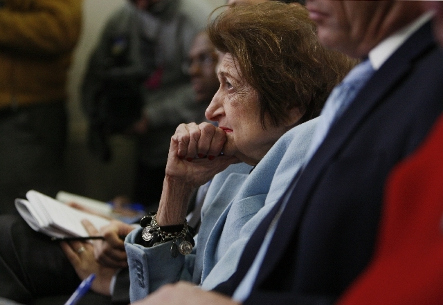 In this Feb. 25, 2009, file photo veteran White House correspondent Helen Thomas listens as White House Press Secretary Robert Gibbs answers her question during his daily press briefing in Washington.