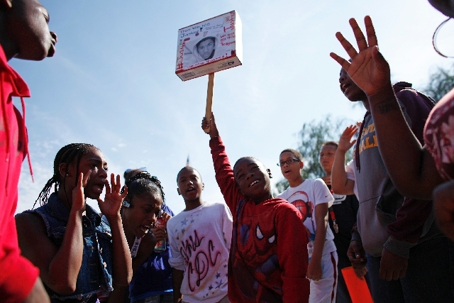 People chant during a rally in support of Justice for Trayvon Martin outside of the federal courthouse in Las Vegas Saturday.