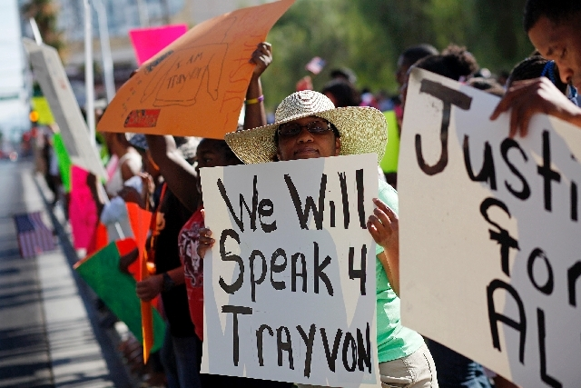 Teresa Love holds up a sign during a rally in support of Justice for Trayvon Martin outside of the federal courthouse in Las Vegas Saturday.