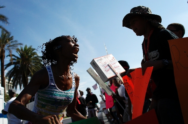 Lekisha Hayes, left, leads others in a chant during a rally in support of Justice for Trayvon Martin outside of the federal courthouse in Las Vegas Saturday.