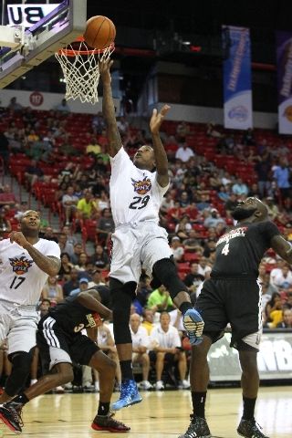Phoenix Suns rookie guard Archie Goodwin cuts through traffic for a layup during a quarterfinal victory over the Toronto Raptors in the NBA Summer League on Saturday at the Thomas & Mack Center.
