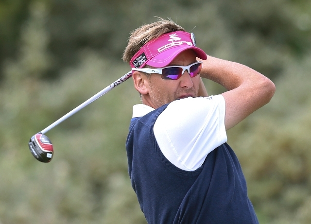 Ian Poulter of England plays a shot off the third tee during the final round of the British Open Golf Championship at Muirfield, Scotland, Sunday.