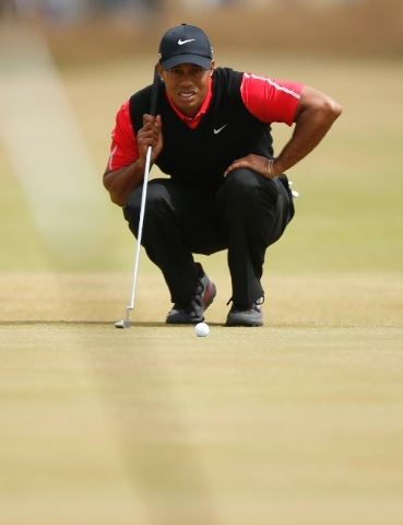 Tiger Woods of the United States lines up a putt on the first green during the final round of the British Open Golf Championship at Muirfield, Scotland, Sunday.