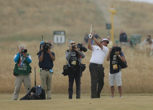Phil Mickelson of the United States plays a shot on the 18th fairway during the final round of the British Open Golf Championship at Muirfield, Scotland, Sunday.