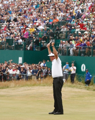 Phil Mickelson of the United States celebrates after his final putt on the 18th green during the final round of the British Open Golf Championship at Muirfield, Scotland, Sunday.