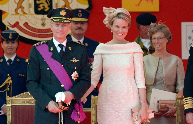 Belgium's King Philippe, second left and Queen Mathilde, second right, review the troops during a military parade in Brussels on Sunday.