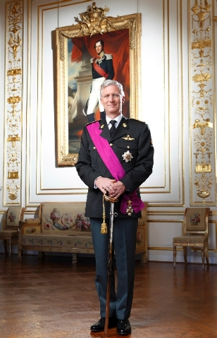 In this photo released by the Belgian Prime Ministers Office, Belgium's King Philippe poses for a photo at the royal palace in Brussels on Sunday.