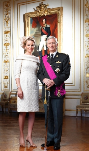 In this photo released by the Belgian Prime Ministers Office, Belgium's King Philippe, right, and Queen Paola pose for a photo at the royal palace in Brussels on Sunday.