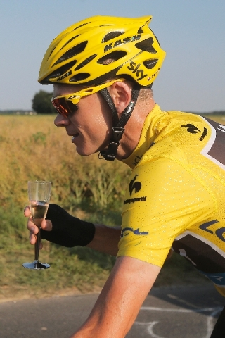 Christopher Froome of Britain, wearing the overall leader's yellow jersey, drinks a glass of champagne during the 21st and last stage of the 100th edition of the Tour de France cycling race over 1 ...