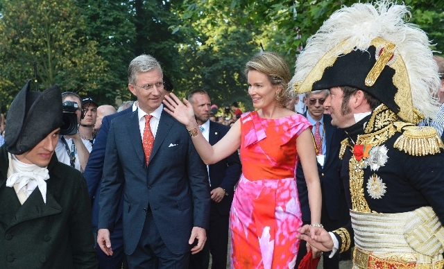 Belgium's Queen Mathilde, center right, and her husband King Philippe, center left, wave to the  public during a walk in the Parc Royale in Brussels on Sunday.