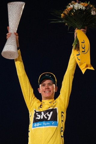 2013 Tour de France cycling race winner Christopher Froome of Britain, wearing the overall leader's yellow jersey, celebrates on the podium of the 100th edition of the Tour de France cycling in Pa ...